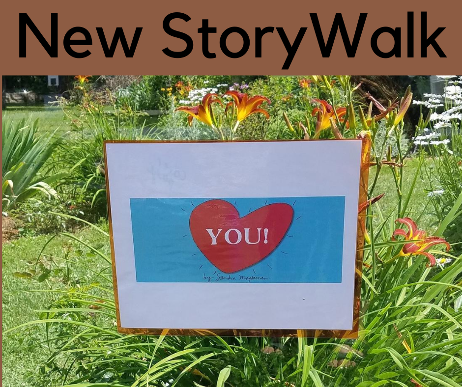 New Story Walk image of sign with heart and the word You inside it.